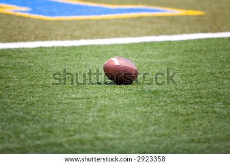An American style football on a football field