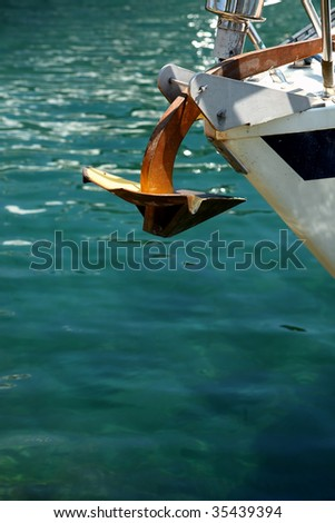 An anchor on the bow of a small ship.