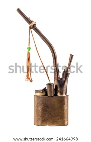 an ancient chinese Hookah or shisha pipe unsed to smoke cigarettes having the smoke filtered in water isolated over a white background - stock photo