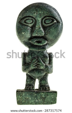 an ancient pagan statuette isolated over a white background - stock photo