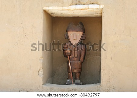 An ancient statue found at the ancient city of Chan Chan Peru - stock photo