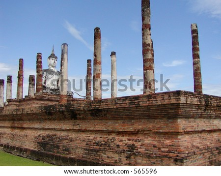 An ancient Thai temple, with buddha; roof is gone