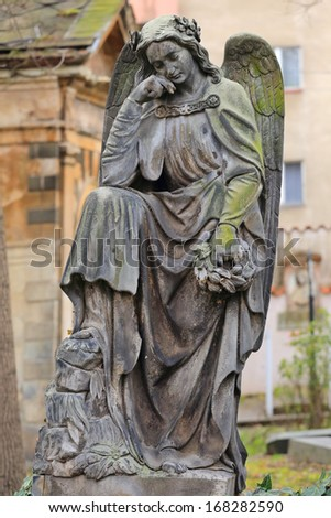 An Angel at the old Prague Cemetery, Czech Republic - stock photo