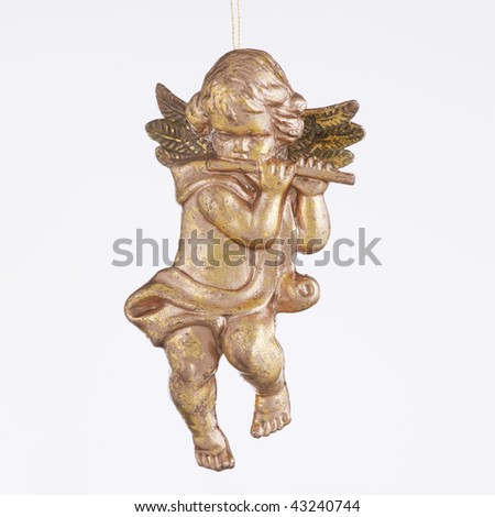 An angel playing a flute ornament against a white background in the square format.