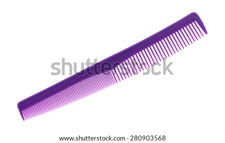 An angle view of a purple fine tooth comb on a white background. - stock photo