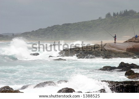 An Angler on a rocky shore in Kwa-Zulu Natal South Africa - stock photo