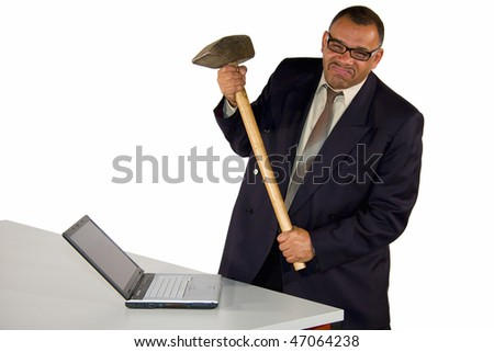 an angry and fierce looking mature African-American businessman aiming with a sledgehammer at his laptop, isolated on white background - stock photo