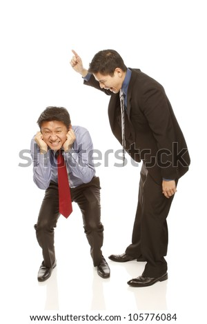 An angry boss scolding a worker (isolated on white) - stock photo