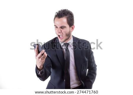 An angry businessman shouting at the phone - stock photo