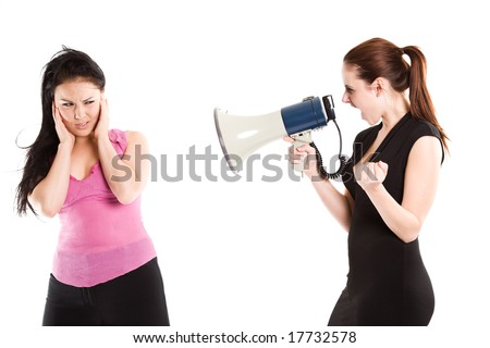 An angry businesswoman shouting toward her colleague using a megaphone - stock photo
