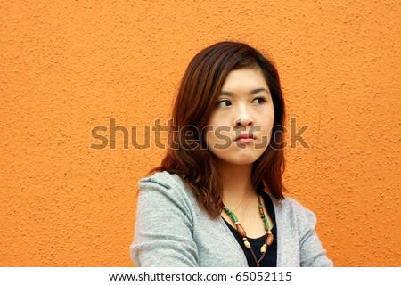 An angry Chinese beautiful girl - stock photo