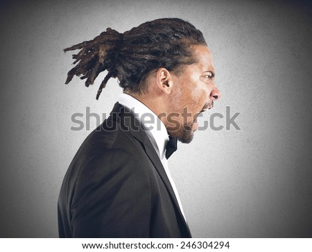 An angry man screams all his anger - stock photo