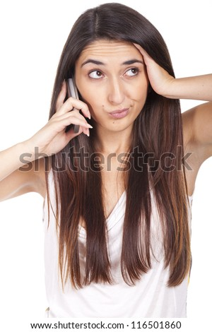 An annoyed and very disappointed business woman on the phone - stock photo