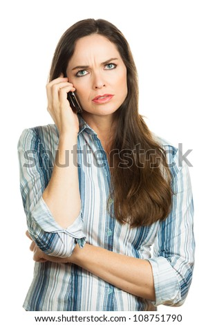 An annoyed and very disappointed business woman on the phone. Isolated over white.