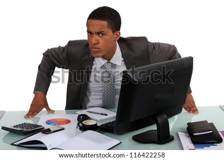 An annoyed businessman - stock photo