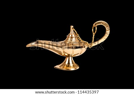 An antique brass oil lamp of genie fame truly isolated on black so designers can easily select it for placement in their projects.
