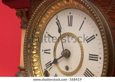 An antique chiming mantle clock made in the 1890's - stock photo
