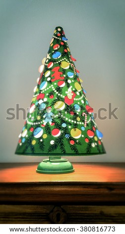 an antique christmas tree lamp spins from the heat given off by the light bulb - Antique Christmas Lights