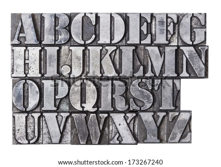 An antique lead letterpress alphabet isolated on a white background.