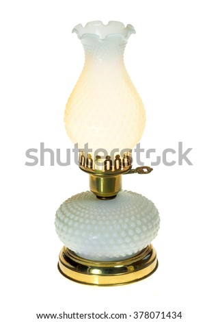 An Antique Lit Table Lamp Isolated on White - stock photo