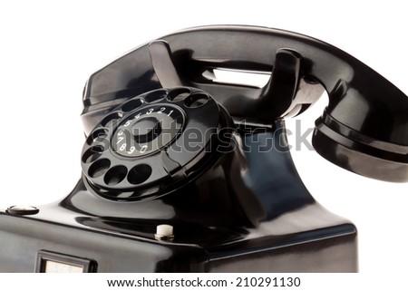 an antique, old landline telephone. phone on white background. - stock photo