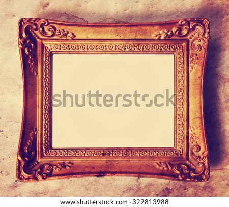 an antique photo frame toned with a retro vintage instagram filter app or action effect - stock photo