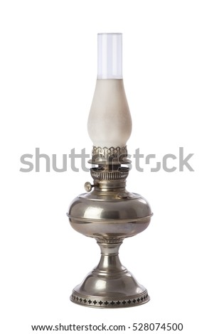 An antique silver colored oil lamp isolated on a white background