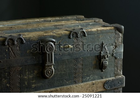 An antique steamer trunk from 1889. - stock photo
