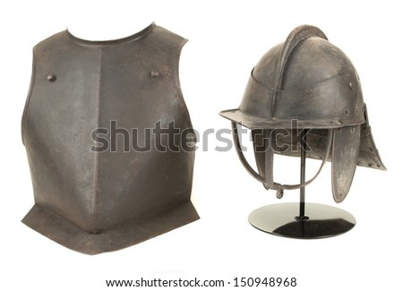 An Antique 17th Century English Civil War Period Lobstertail Cavalry Helmet with Breastplate Isolated on White Background - stock photo