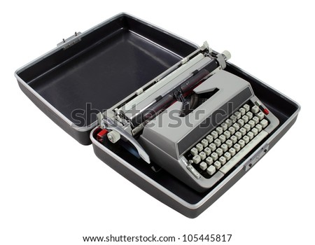 An antique typewriter in protective case on white
