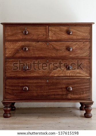 An antique wooden chest of drawers