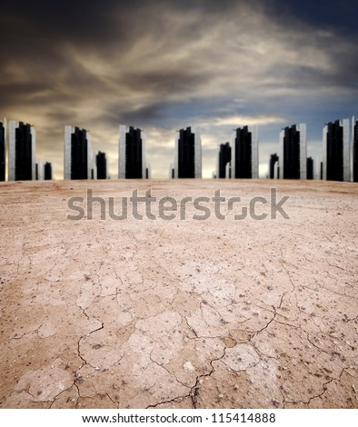 An apocalyptic surreal sky over an arid urban wasteland of skyscraper silhouette across the horizon. - stock photo