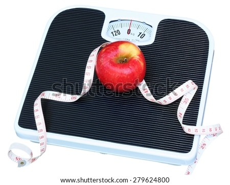 An apple a day keeps the doctor away: Red apple and measuring tape on a set of bathroom scales - stock photo