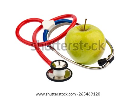 an apple and a stethoscope with a doctor. symbolic photo for healthy, vitamin-rich diet. - stock photo