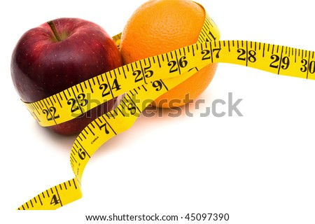 An apple and an orange with a measuring tape on a white background, healthy living