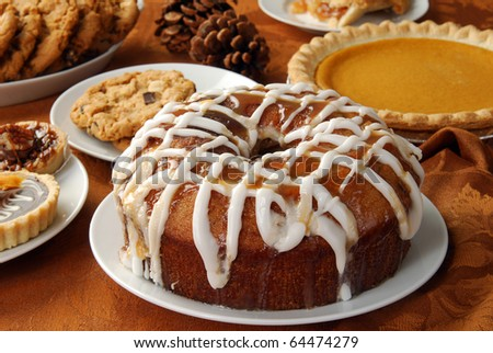 An apple bundt cake with caramel glaze and frosting and other holiday treats