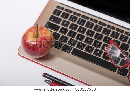 An apple on a computer keyboard