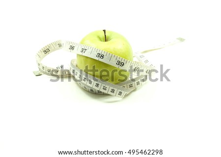 An apple with measuring tape. Weight loss and healthy concept.
