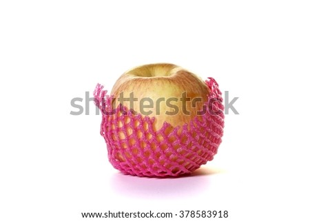 An apple with pink sponge wrapping isolated white