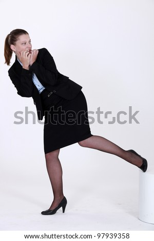 An apprehensive businesswoman - stock photo