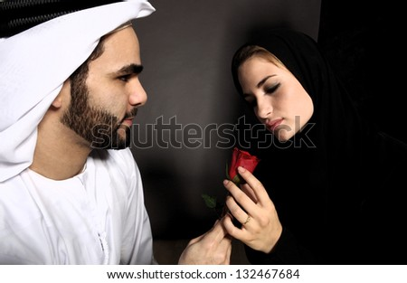 An Arab Man Declares His Emotions With A Rose - stock photo