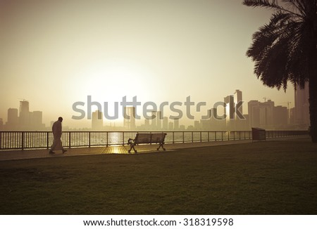 An arab man taking a walk in the city on early morning. - stock photo