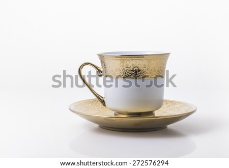 An arabic golden coffee cup with saucer. - stock photo