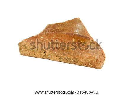An archeological sherd fragment of ancient pottery isolated on white background - stock photo