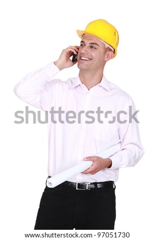 An architect chatting over the phone. - stock photo