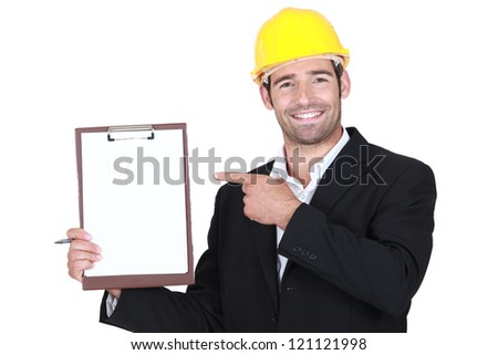 An architect pointing at his clipboard. - stock photo