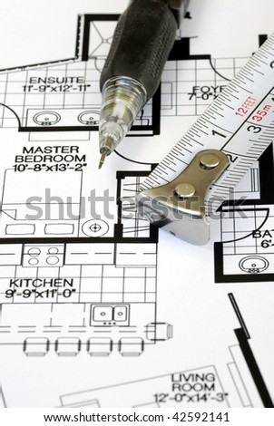 An architect prepares the floorplan for a residence
