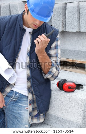 An architect talking over a talkie. - stock photo