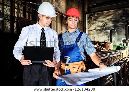 An architecture and worker at a manufacturing area. - stock photo