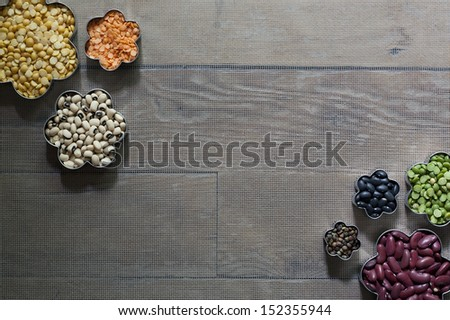 An arrangement of colorful dried legums on a screen background. - stock photo